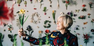 Artist Ann Wood recreates flowers, insects, fruits, vegetables, and other earthly items using handcut paper and mixed media