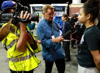 Mike Max interviewing protesters